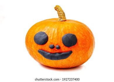Lonely orange yellow pumpkin on white background decoration happy smile face.