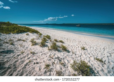 lonely paradise beach with turquoise water and white sand, Klein Bonaire, Caribbean