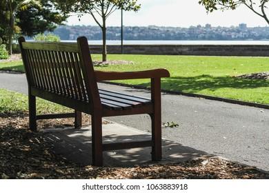 a lonely park bench in sydney harbour park australia