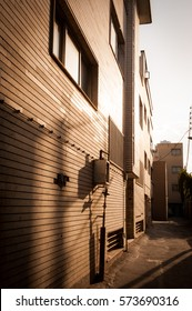 A lonely passage beside the building with sunshine and shadow.