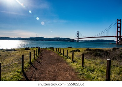 Lonely path with the golden gate bridge in the background