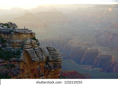 A lonely person enjoying the sunset at Yavapai Point in the South Rim of the Grand Canyon National Park, Arizona, USA.