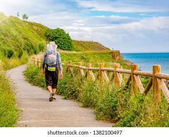Lonely Pilgrim with backpack walking the Camino de Santiago in Spain, Way of St James