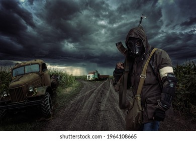 lonely post apocalyptic survivor in mask wanders through the wasteland.