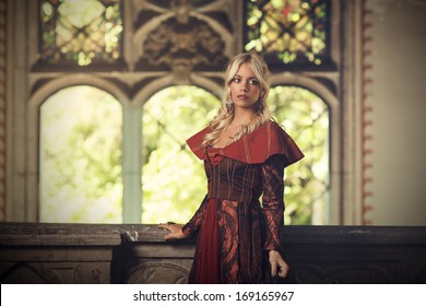Lonely princess stands on the balcony and looking away