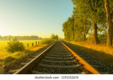 Lonely railroad track in the morning play of colors
