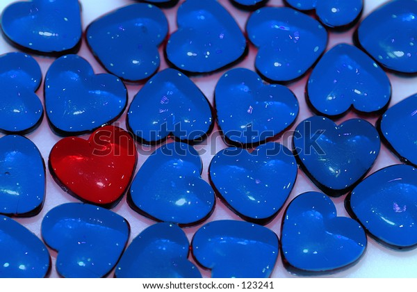 A lonely red heart amongst it's blue companions...