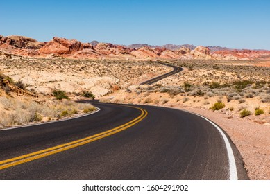 lonely road and beautiful red rock formation in valley of fire near las vegas