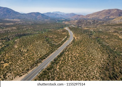 Lonely road in wilderness area of Mojave Desert in southern California.