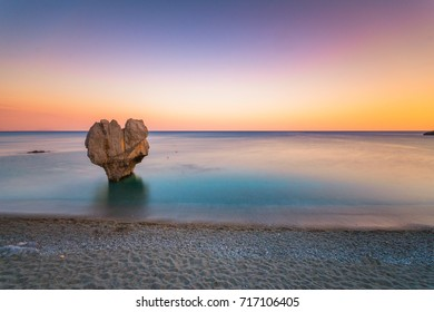 Lonely rock sculpture at the shape of heart, Preveli, Crete, Greece