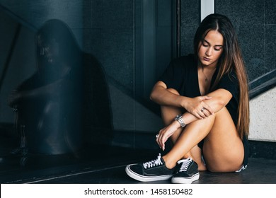 lonely and sad girl sitting on the floor