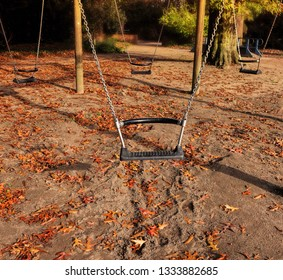 Lonely seesaw . Abandoned swing in empty autumn park. Forgotten childhood