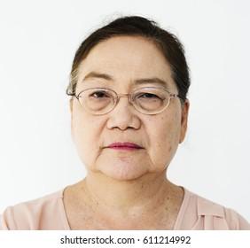 Lonely senior adult woman casual studio portrait