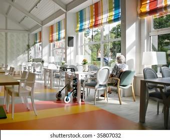 lonely senior in cafe of elderly house