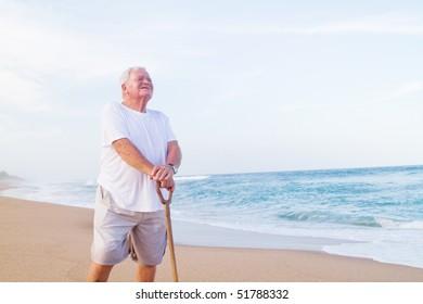 lonely senior man on beach
