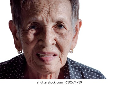 Lonely senior woman smiling in camera