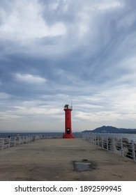 Lonely sky and red lighthouse
