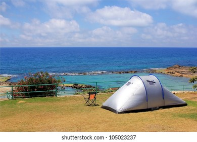 lonely standing tent for camping on the banks of a quiet lagoon on the background of the beautiful sea and sky