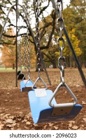 lonely swing set in a park during Autumn.