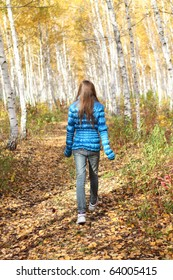 Lonely teenage girl in the autumn forest