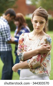 Lonely Teenage Girl Jealous Of Couple In Background