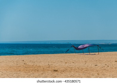 Lonely tent on empty beach