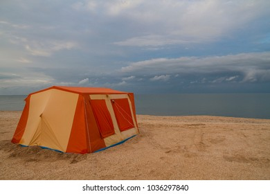 lonely tent on the ocean shore. ecological journey for solitude.