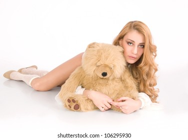Lonely, tired girl hug the furry bear and relax