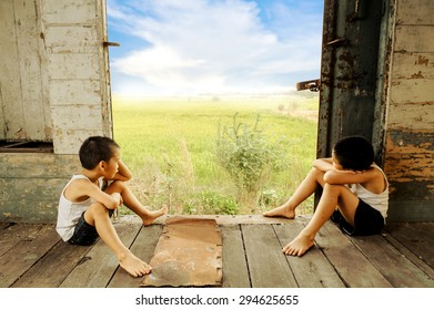 The lonely two boy the old room looking to outside to rice field on blue sky white cloud
