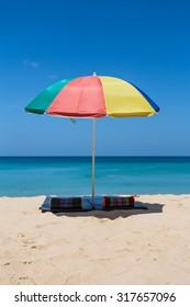 Lonely umbrella at Surin beach