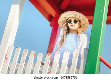 Lonely unhappy young girl at playground alone.