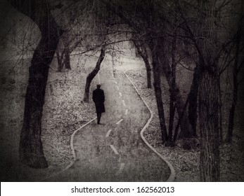 Lonely walk, rite of passage concept, metaphorical image edited in the antique (vintage) style.