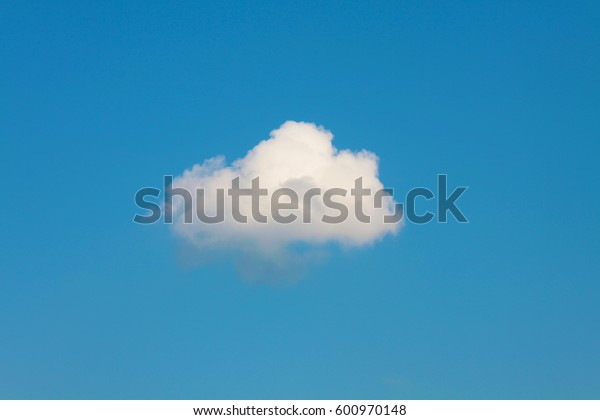 Lonely white cloud on a blue sky