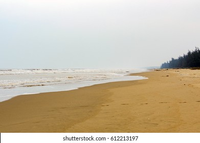 Lonely wild sand beach in Vietnam. Sea storm and cloudy sky