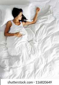 lonely woman in bed missing her partner overhead view of sleeping beauty