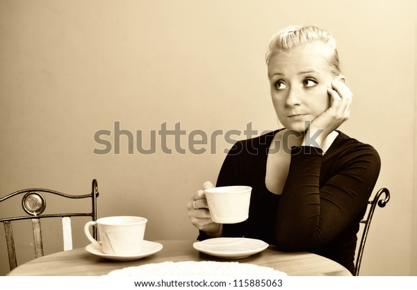 Lonely woman in cafe. Late for a date.