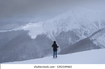 Lonely woman facing a challenge in the mountains, Pyrenees, Navarra