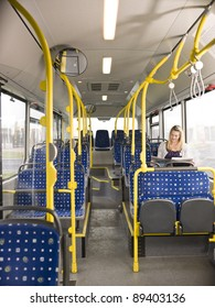 Lonely woman on the bus reading a newspaper