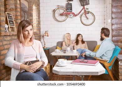 Lonely woman waiting for someone in cafe
