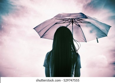 lonely women alone in an empty rain