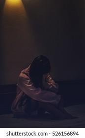 lonely women alone in an empty room