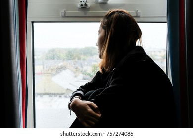 Lonely Women Sitting at The Window