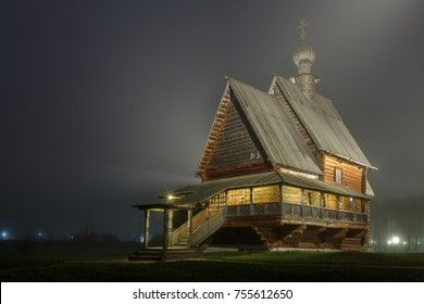Lonely wooden Church of St. Nicholas in Suzdal foggy autumn night