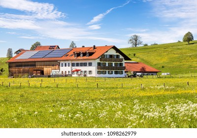 The lonely wooden house in the spring the lawn in Bavaria