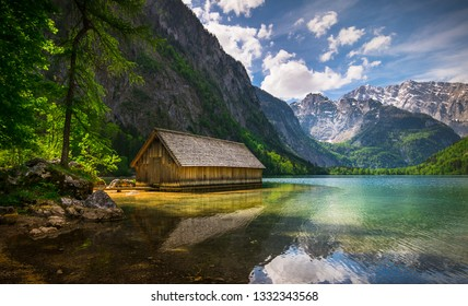 Lonely wooden hut on a mountain lake
