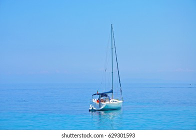 A lonely yacht in the blue sea