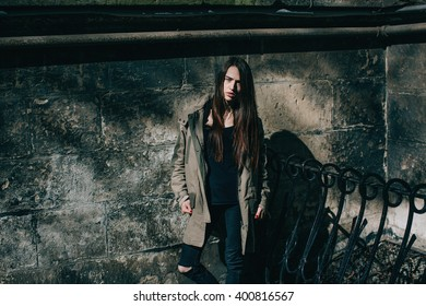 Lonely Young hipster girl on street