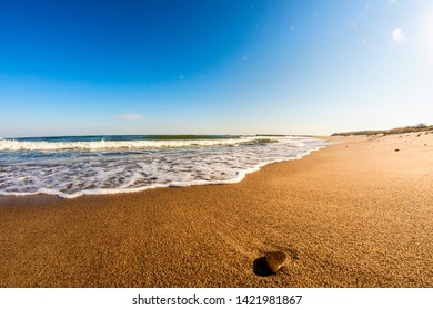 lonesome beach of the Baltic Sea with pebble and surf