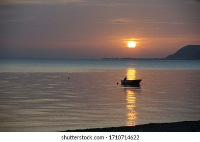 Lonesome Fishingboat at Sunset on the Sea