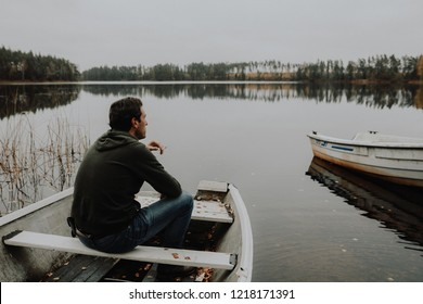 Lonesome Guy In Skiff At Lake During Indian Summer in Sweden